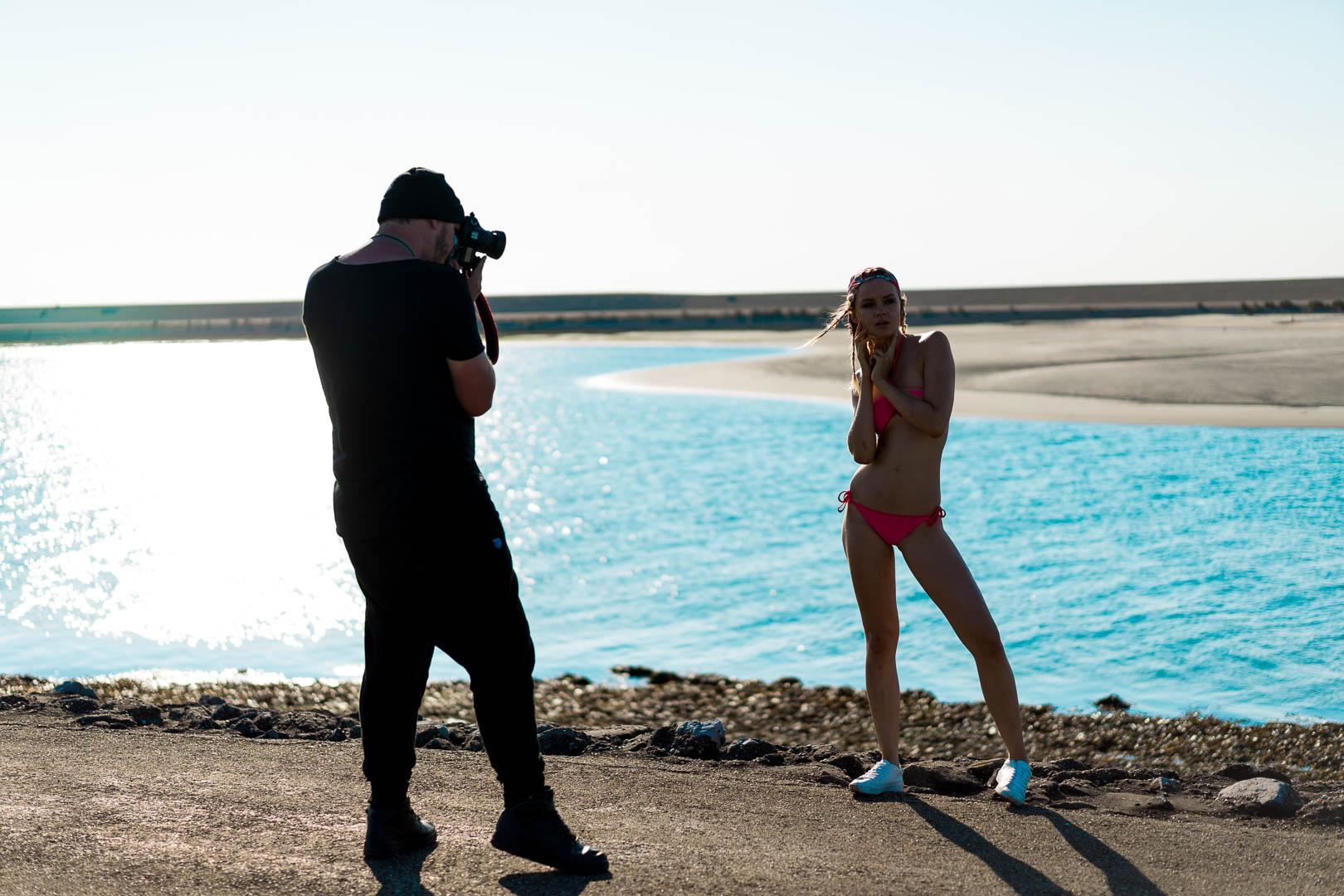photographer-shooting-editorial-modeling-agency-ocean-beach-rocks-zara-bikini-model